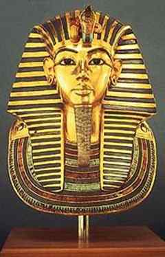 Egyptian, New Kingdom, Dynasty 18 (ca. 1332-1323 B.C.). Gold Mask of Tutankhamun. Gold, lapis lazuli, colored glass, faience, quartz, carnelian, obsidian and feldspar. H. 50.4 cm; W. 39.3 cm. Thebes, Valley of the Kings, Tomb of Tutankhamun (KV 62). Egyptian Museum, Cairo. Photograph by Lee Boltin.