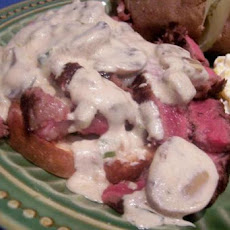 Steak Served on Parmesan Toasts With Sour Cream/Onion/Garlic Sau