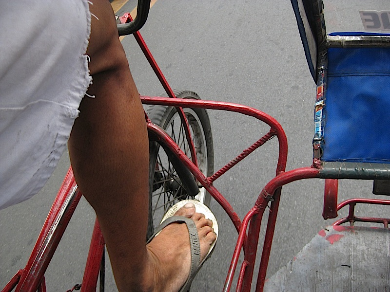 a view of the road from inside a pedicab