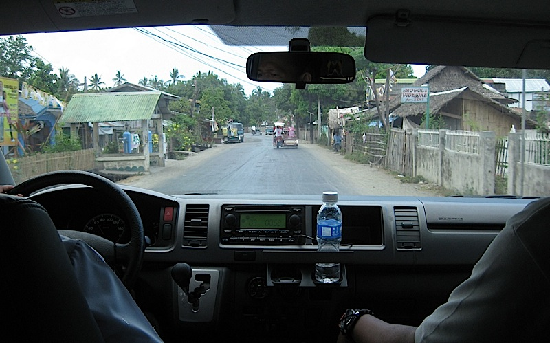 a small town in Marinduque through a van's windshield