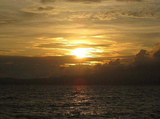 sunset over the Bataan Peninsula from the middle of Manila Bay