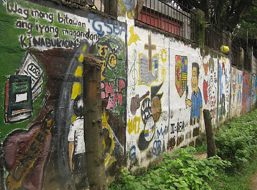 wall of Claret School of Quezon City painted by children with illustrations
