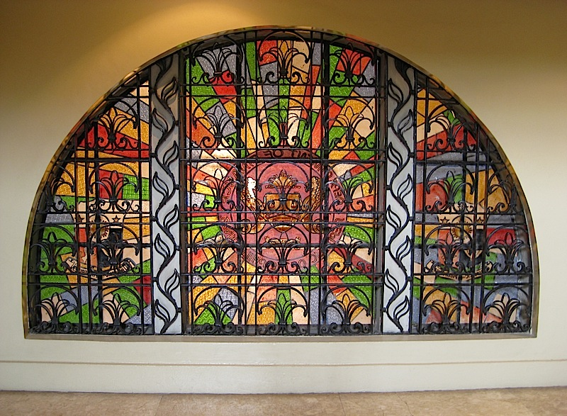 arched stained glass window with black iron grills at the Museum of the Filipino People