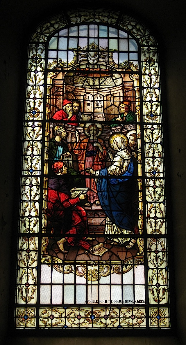 stained glass window at the Notre-Dame de Québec depicting the finding of Jesus in the temple