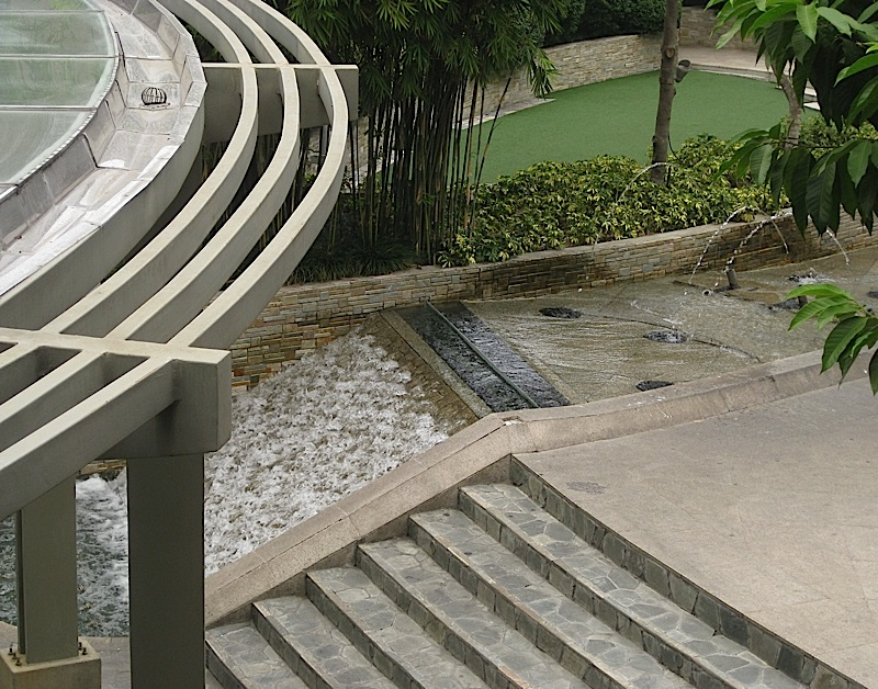 river and cascade water feature at TriNoma mall