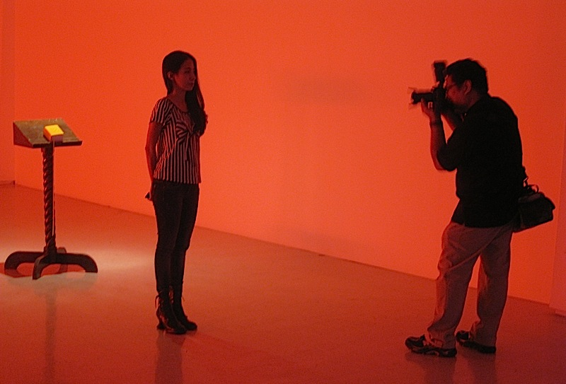 artist Kiri Dalena being photographed by Cocoy Sarmenta