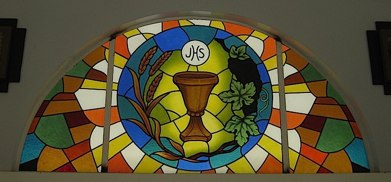stained glass window with wheat, grape vines and a chalice