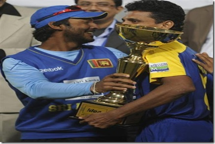 Kumar Sangakkara and Suraj Randiv pose with the trophy after Sri Lanka beat India by four wickets.