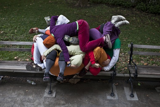 "Performers situate themselves into position during a piece entitled ""Bodies in Urban Spaces"" by choreographer Willi Dorner.  Starting at sunrise, the performers inched their way into different spaces throughout lower Manhattan.<br /><br />CREDIT: Bryan Derballa for The Wall Street Journal<br />NYBODIES"