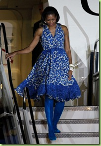First lady Michelle Obama walks down the presidential airplane upon her arrival in Mexico City, Tuesday, April 13, 2010. Obama is on a three-day visit to Mexico. (AP Photo/Eduardo Verdugo)