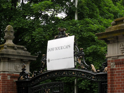 Doff your caps sign on the Van Wickle Gates at Brown University during commencement