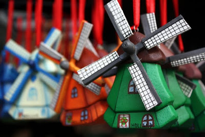 Windmill ornaments for sale at a shop in Amsterdam in The Netherlands