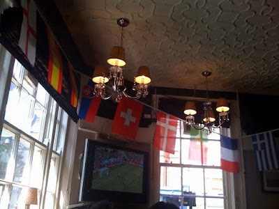 Flags in the King William IV pub in London during the World Cup