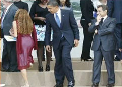 President Barack Obama seemingly checking out the backside of a girl at the G-8 summit in Italy picture