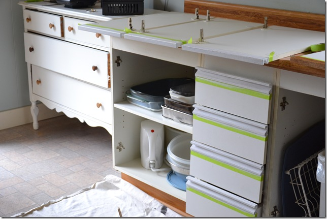 European cupboard doors with melamine fronts and oak trim rail at the top get an updated look with this painted cabinet project.