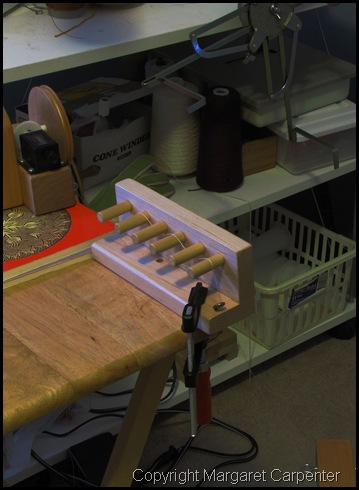 Tension box with skein winder