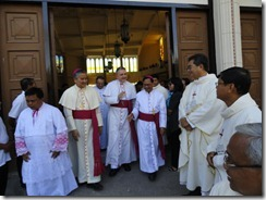 Msgr. Joseph Edwards Adams being received by Msgr. Villegas and Msgr. Mayugba