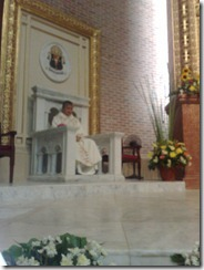 Archbishop Socrates B. Villegas, DD sitting on the Archbishop's cathedra.