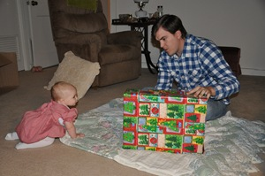 Isla and Daddy open presents