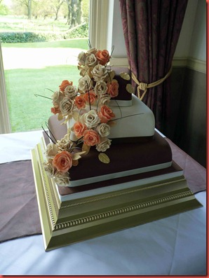 3-tier-Rose-with-chcolate-and-ivory-layers-wedding-cake-at-dunkenhalgh