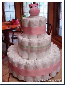 Diaper cake with ribbon affixed