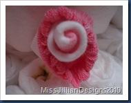Pink & white baby sock rosette