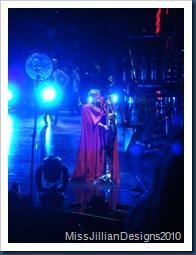 Lady Gaga playing some kind of harp