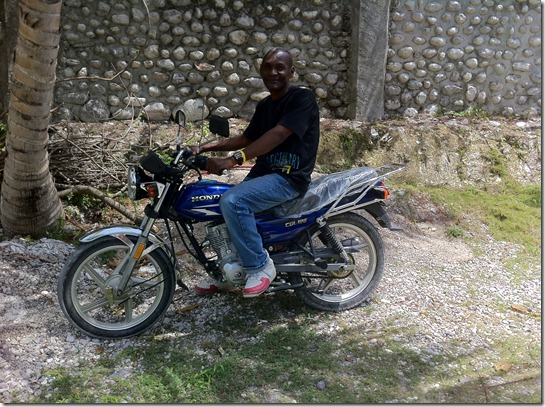 Pastor Sony Nerjuste picking up his new bike