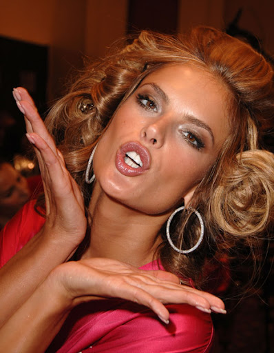 Model Alessandra Ambrosio getting hair and makeup done before the 12th