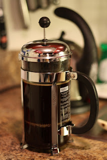 picture of french press with plunger pressed
