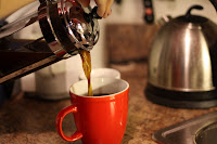 picture of pouring coffee from french press to mug