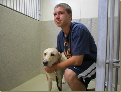 James and Reyna saying good bye in the kennel.