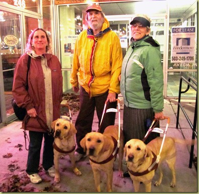 Mojave's handler, Novak's handler and Carol and Reyna standing outside the restaurant.