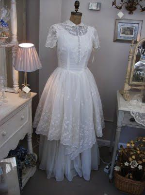 display the gown in her living room or bedroom on a dress form