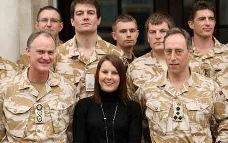 Kelly Shepherd, the widow of Captain Daniel Shepherd, stands with alternative recipients of troops honours