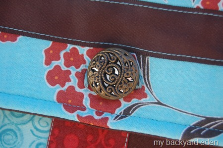 vintage button on messenger bag