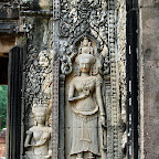 Thommanon - Two devata (sacred female image) in different styles: at left the folded sampot (skirt) is common at Angkor Wat; on the right, a pleated style that is less common there.  Both devata display a characteristic mudra with both hands. Siem Reap, Cambodia http://www.Devata.org