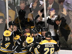 The Bruins celebrate Steve Kampfer's goal in the third period