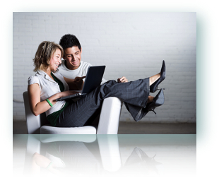 A couple kicking back, using a laptop to request online Nevada payday loans.