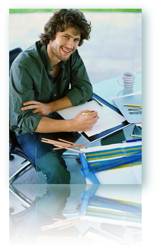 A man sitting at the table with pencils, paper, charts, etc.