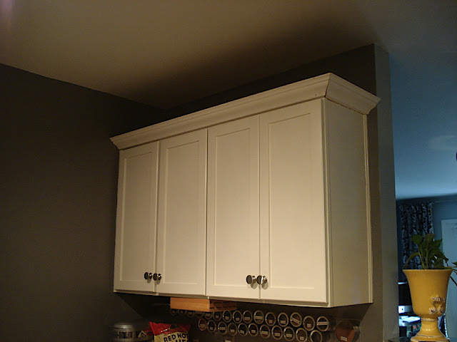Adding crown molding to kitchen cabinets for Attaching crown molding to kitchen cabinets