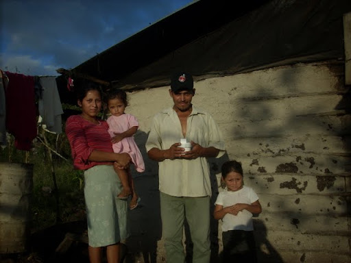 Santos Federico and His Family with a Solar Lamp