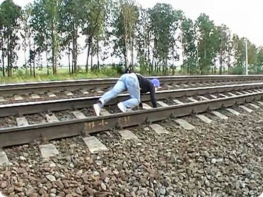 Dangerous Play by Russian Teens in railway track