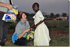 Suzanne handing out wash bags to children