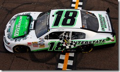 2011 Phoenix Feb NNS Kyle Busch with checkered flag