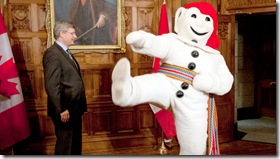 Prime Minister Harper getting the boot from Bonhomme?