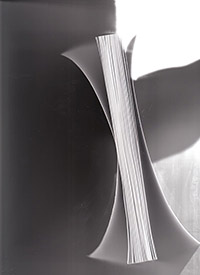 scan of book showing soft cover curl