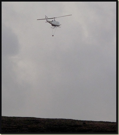 This helicopter spent all day dropping bags of hessian around us