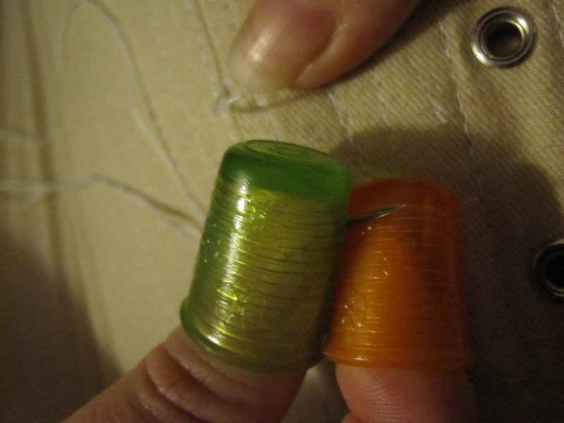 Repairing the split: rubber thimbles were required to pull out the really stiff needle