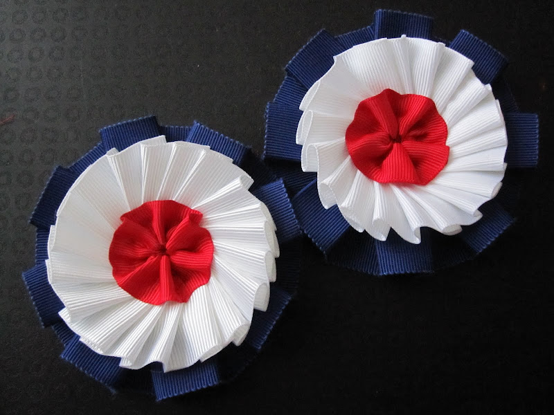 A pair of red, white and blue cockade's - front